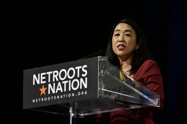 Councilmember Helen Gym takes the stage ahead of the Netroots Nation presidential candidate forum at the Convention Center in Philadelphia on July 13, 2019. (Bastiaan Slabbers for WHYY)