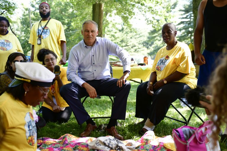 Democratic presidential hopeful Jay Inslee joins activist with Philly Thrive for a community BBQ, in Fairmount park, on Saturday. (Bastiaan Slabbers for WHYY)