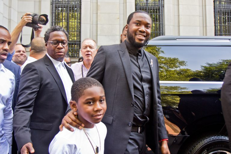 "Rapper Robert Rihmeek Williams ""Meek Mill"" with his son, Rihmeek Williams. Mill appeared in Superior Court Tuesday. His lawyers are arguing for a retrial. (Kimberly Paynter/WHYY)"