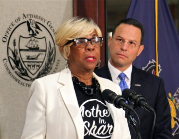 With tear-filled eyes, Mothers in Charge Executive Director Dorothy Johnson-Speight joins Pennsylvania Attorney Genteral Josh Shapiro to announce grant funding for Operation LIPSTICK, aimed at educating women about the dangers of straw purchases. Johnson-Speight's son was killed with a gun purchased by the shooter's girlfriend