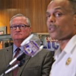 Mayor Jim Kenney listens as Philadelphia Police Commissioner Richard Ross answers reporters questions about an investigation into racist Facebook posts by active duty police officers. (Emma Lee/WHYY)