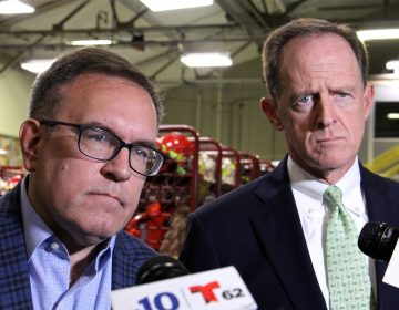Environmental Protection Agency administrator Andrew Wheeler (left) and U.S. Sen. Pat Toomey (R-Pa.) visit Monroe refinery in Trainor, Pa., to discuss eliminating the federal regulation that requires blending ethanol with gasoline. (Emma Lee/WHYY)