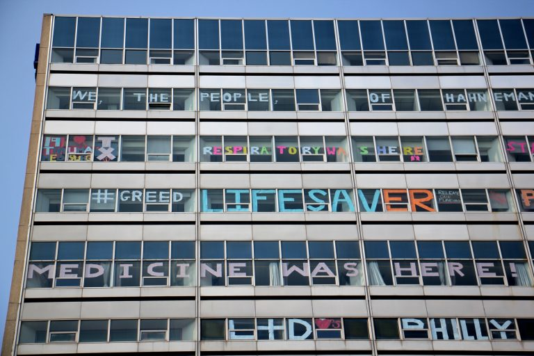 Hahnemann Hospital windows are decorated by employees as the hospital prepares to close. (Emma Lee/WHYY)