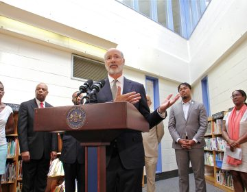 Gov. Tom Wolf visits the newly painted library at Edward Heston School in Philadelphia to announce $4.3 million in state funding for lead paint stabilization at Philadelphia school buildings. (Emma Lee/WHYY)