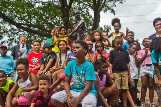 "Smith Playground summer camp participants, and Boys and Girls Club members take the first photos in from of the ""MVP"" Ora Washington statue. (Kimberly Paynter/WHYY)"
