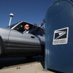 In this photo taken Feb. 24, 2012, mail is deposited into an outdoor postal box (Rich Pedroncelli/AP Photo)