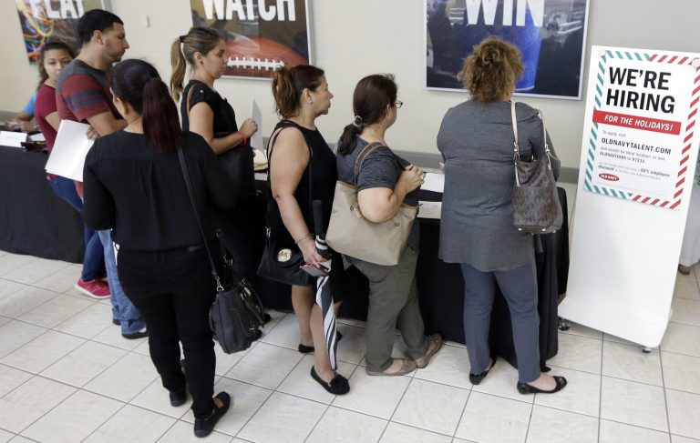 In this Tuesday, Oct. 3, 2017, photo, job seekers wait in line at a job fair (Alan Diaz/AP Photo)