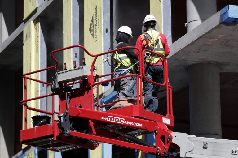 Workers labor at the construction site of a condominium building in the Newport section of Jersey City, N.J., Wednesday, May 2, 2018. (AP Photo/Julio Cortez)