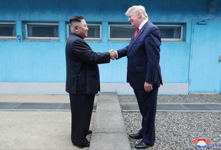 In this Sunday, June 30, 2019, photo provided by the North Korean government, North Korean leader Kim Jong Un, left, and U.S. President Donald Trump shake hands over the military demarcation line at the border village of Panmunjom in Demilitarized Zone. The content of this image is as provided and cannot be independently verified. Korean language watermark on image as provided by source reads: