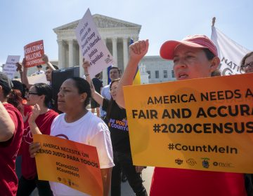 In this June 27, 2019, file photo, Demonstrators gather at the Supreme Court as the justices finish the term with key decisions on gerrymandering and a census case involving an attempt by the Trump administration to ask everyone about their citizenship status in the 2020 census, on Capitol Hill in Washington. The Justice Department said Tuesday that the 2020 Census is moving ahead without a question about citizenship. (J. Scott Applewhite/AP Photo, File)