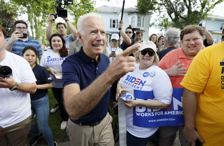 Former vice president and Democratic presidential candidate Joe Biden greets supporters before walking in the Independence Fourth of July parade, Thursday, July 4, 2019, in Independence, Iowa. (Charlie Neibergall/AP Photo)