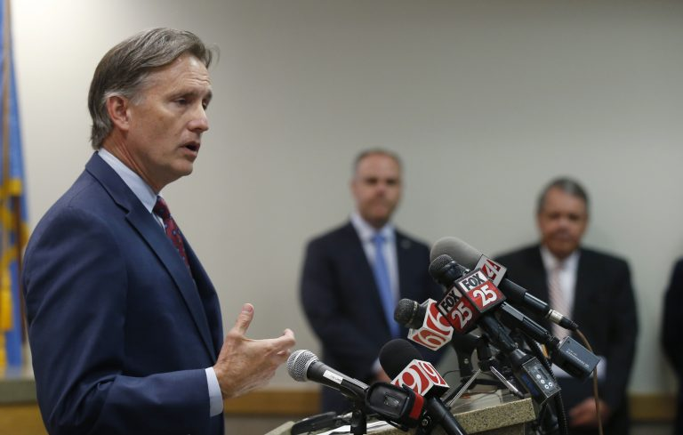 Oklahoma Attorney General Mike Hunter speaks to the media at a news conference following closing arguments in Oklahoma's ongoing opioid drug lawsuit against Johnson & Johnson Monday, July 15, 2019, in Norman, Okla. (Sue Ogrocki/AP Photo)