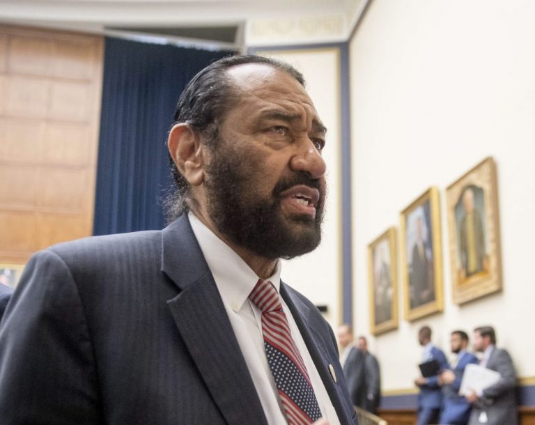 Rep. Al Green, D-Texas, right, speaks to visitors during a break from testimony from David Marcus, CEO of Facebook's Calibra digital wallet service, before a House Financial Services Committee hearing on Facebook's proposed cryptocurrency on Capitol Hill in Washington, Wednesday, July 17, 2019. Green has introduced a resolution in the House to impeach President Donald Trump. (Andrew Harnik/AP Photo)