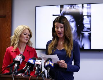 Model Janice Dickinson, (right), speaks at a press conference, Thursday, July 25, 2019, in Los Angeles, announcing a settlement of her defamation lawsuit against comedian Bill Cosby. The deal allows Dickinson to continue to speak out against Cosby. Looking on at left is Dickinson's attorney Lisa Bloom. (Katherine Campione/AP Photo)