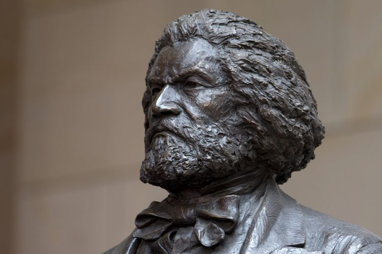 A bronze statue of 19th-century orator and writer Frederick Douglass is seen in the Emancipation Hall of the United States Visitor Center on Capitol Hill in Washington, Wednesday, June 19, 2013, where it was dedicated. The bronze statue of Douglass is by Maryland artist Steve Weitzman. (Carolyn Kaster/AP Photo)