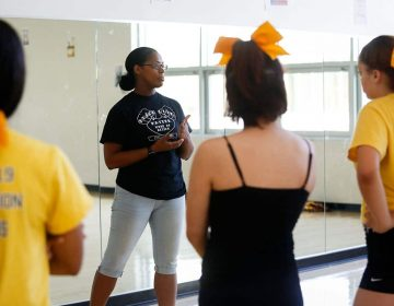 Kensington High School cheerleading coach Amber Rawls leads practice in the dance studio at Kensington High School for the Creative and Performing Arts (KCAPA) on June 6, 2019. (Photo by Maggie Loesch)