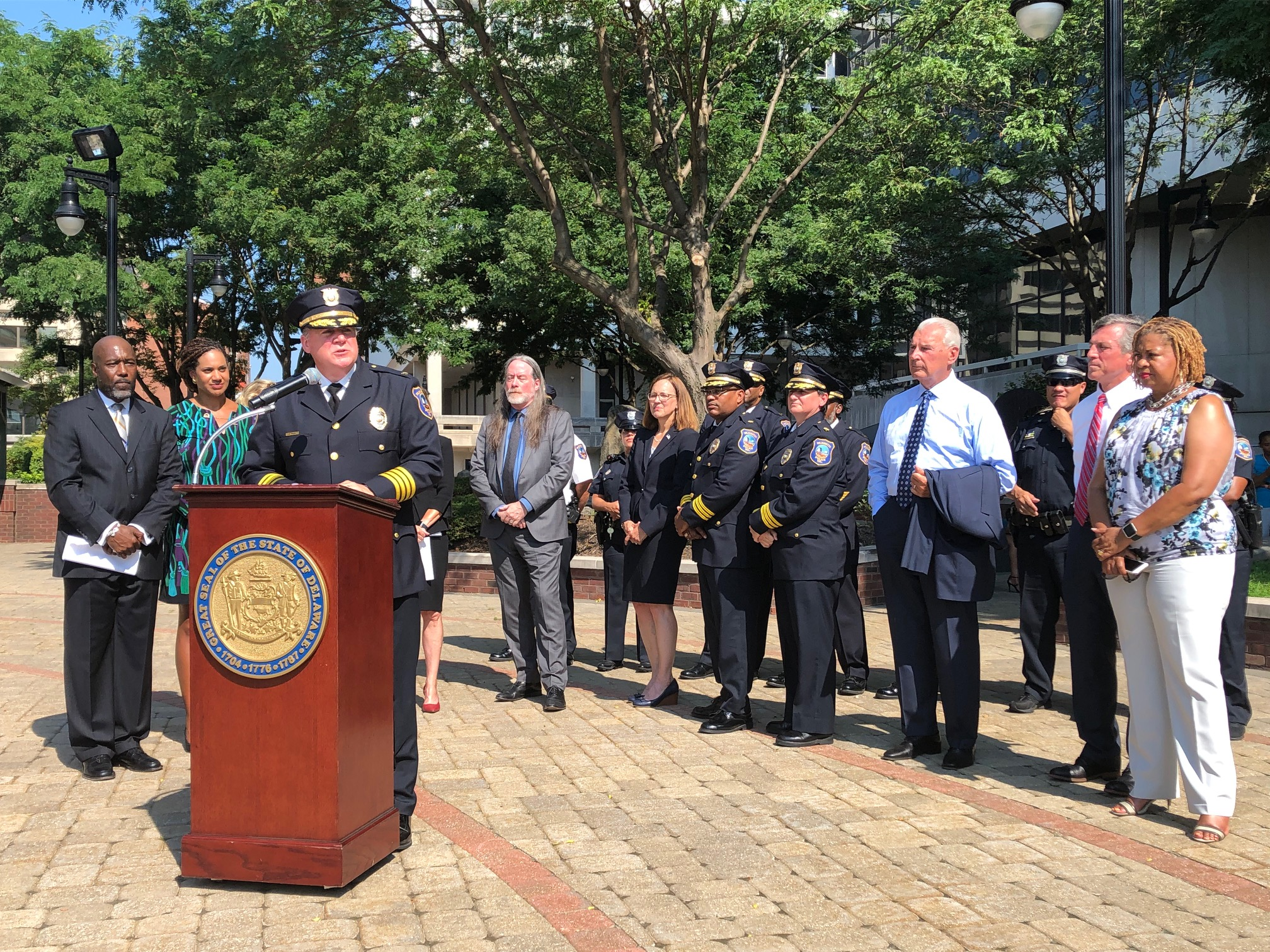 Wilmington police chief Robert Tracy, flanked by city and state officials,
