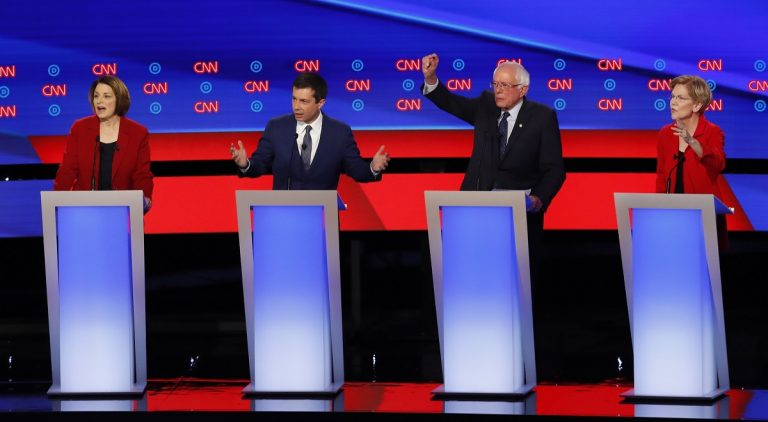 Sen. Amy Klobuchar, D-Minn., from left, South Bend Mayor Pete Buttigieg, Sen. Bernie Sanders, I-Vt., and Sen. Elizabeth Warren, D-Mass., participate in the first of two Democratic presidential primary debates hosted by CNN Tuesday, July 30, 2019, in the Fox Theatre in Detroit. (AP Photo/Paul Sancya)