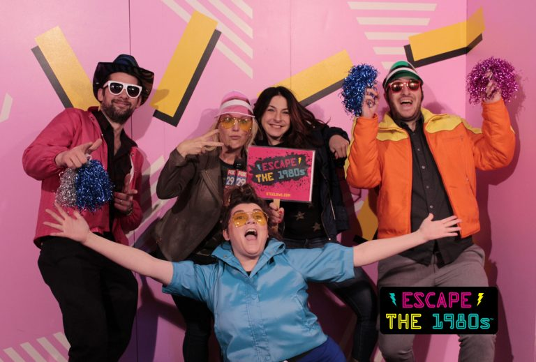 Employees at Escape the 1980s (from left to right): John Foster, Jennaphr Frederick, Elisabeth Garson, Nick Einstman, and Krystle Ann Griffin in the game room's photo booth.  (Image courtesy of Escape the 1980s)