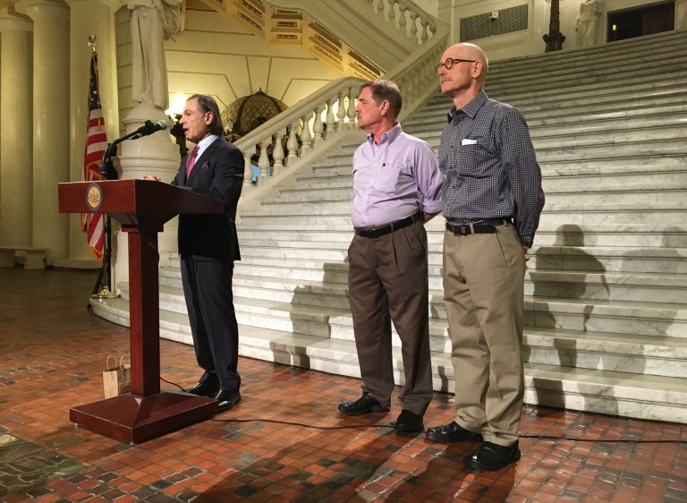 Attorney Richard Serbin (left) and Don Asbee (right) announce the lawsuit at the state Capitol in Harrisburg. David Clohessy, with the Survivors Network of those Abused by Priests, is at center.