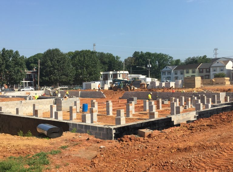 Construction work on the foundations of phase three of The Flats redevelopment is well underway in Wilmington. (Mark Eichmann/WHYY)