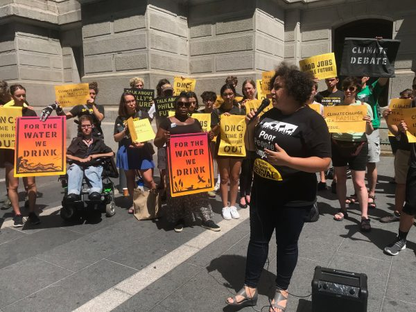 Nijmie Dzurinko, Co-Chair of the Philadelphia Poor People's Campaign, speaks to the crowd about the way climate issues intersect with class issues. (Naomi Brauner/WHYY)