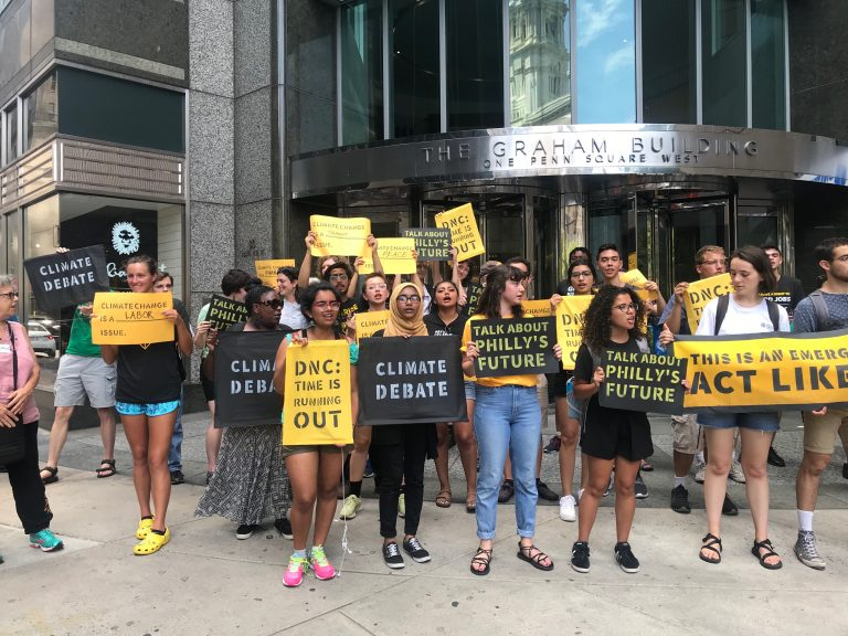 Protesters gather attention outside the building that formerly housed offices of the Pa. Democratic Party. (Naomi Brauner/WHYY)