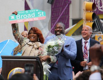 Patti LaBelle holds up a sign named by a portion of Broad Street after her. (Emma Lee/WHYY)