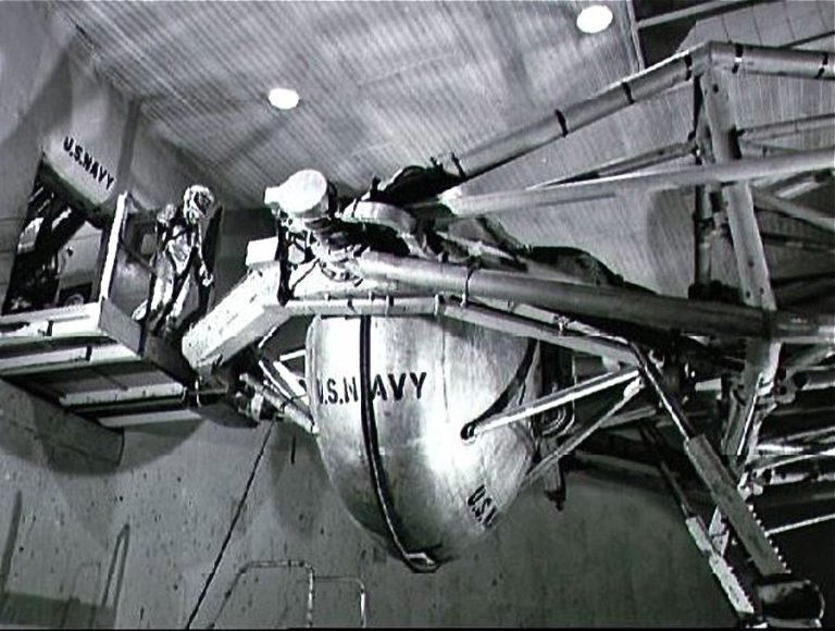 Astronaut Walter M. Schirra Jr. prepares to enter the gondola of a centrifuge which is used to test gravitational stress on astronauts training for space flight. Schirra became the pilot of the Mercury-Atlas 8 six-orbit space mission. Photo taken at Johnsville Naval Air Development Center, Warminster, Pennsylvania. Date Taken:1960-01-01 (NASA)