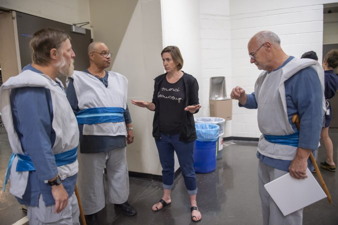 The veterans who portray soldiers in King Lear get final instructions from director Kittson O'Neill; (from left) Nelson Hawthorne, Floyd Crump Jr, O'Neill, and Sheldon Rich. (Jonathan Wilson for WHYY)