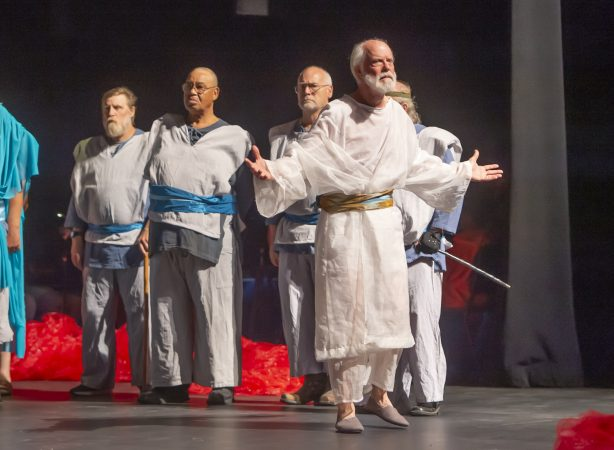 Four veterans portray soldiers in the production of King Lear; (from left) Nelson Hawthorne, Floyd Crump Jr., Sheldon Rich, and John Kearney (partially hidden); King Lear is played by Dan Kern. (Jonathan Wilson for WHYY)