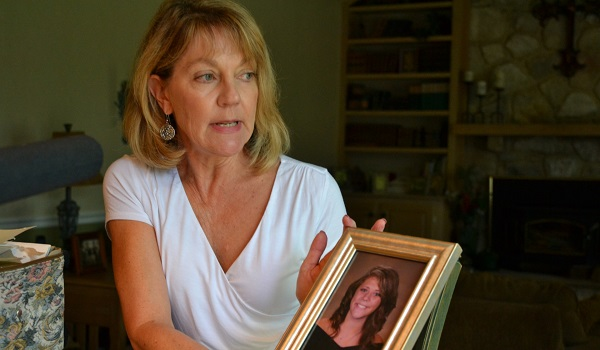 Martha Stringer holds a photo of her daughter, Kim, from when she was in high school. Kim is 27 now. (Brett Sholtis/WITF)