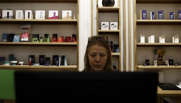 Salesperson Cheri McFarland works on a sales computer in front of displayed marijuana products at Beyond/Hello, Center City Philadelphia's first medical marijuana dispensary on Jan. 24, 2019. (Matt Slocum/AP Photo)