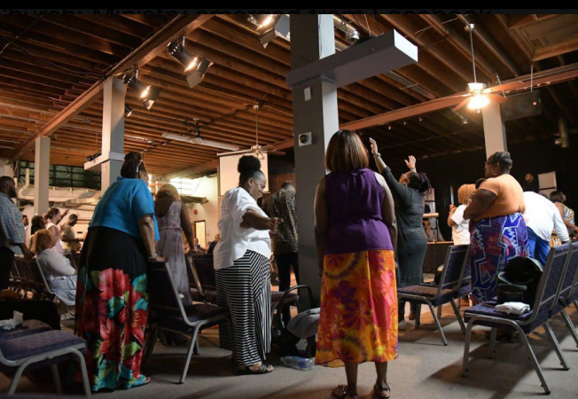 Church members at Truth Church Worship Center praise during Sunday service held at Masters Builders Church in Northeast Philadelphia. A power outage in Overbrook Park where they normally praise caused the congregation to find a temporary place to worship on June 30 (Marissa Weekes Mason/The Philadelphia Tribune)