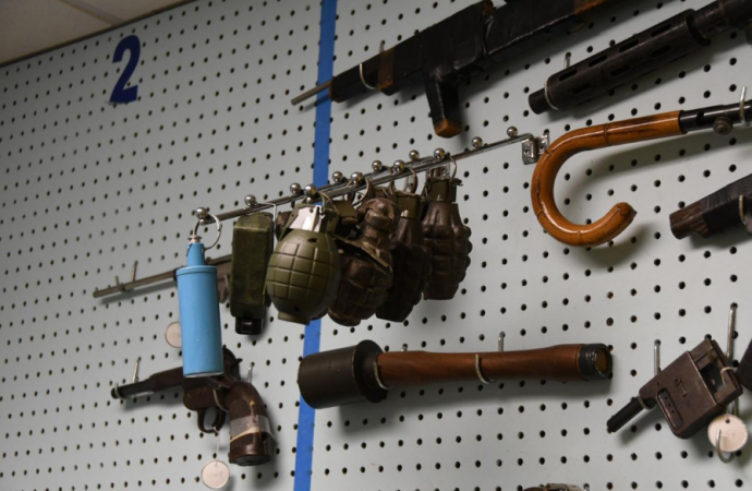 Inactive grenades hang on the wall in the gun archive in the Philadelphia Police Department's Forensic Science Center. (Abdul Sulayman/The Philadelphia Tribune)