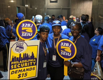 SEIU union members rally inside the first floor of the Municipal Service Building to file a complaint against universities and hospitals, and a contractor for them who the union claims is not paying security workers the prevailing wage on Monday. (Michael D'Onofrio/The Philadelphia Tribune)