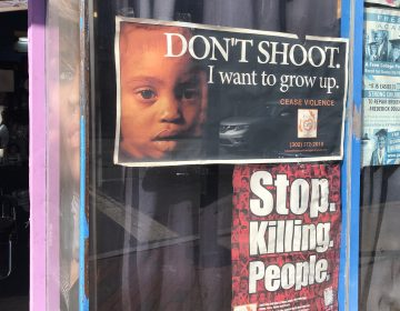 posters on a barbershop window in downtown Wilmington