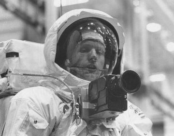 Neil Armstrong tests out his spacesuit and camera in April 1969, three months before he would actually set foot on the moon. (NASA/Project Apollo Archive)