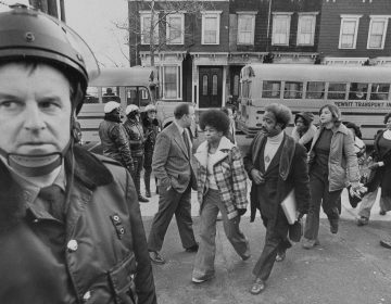 Buses arrive at South Boston High School, Jan. 8, 1975. Police were on hand to provide protection as black students arrived. (AP Photo)