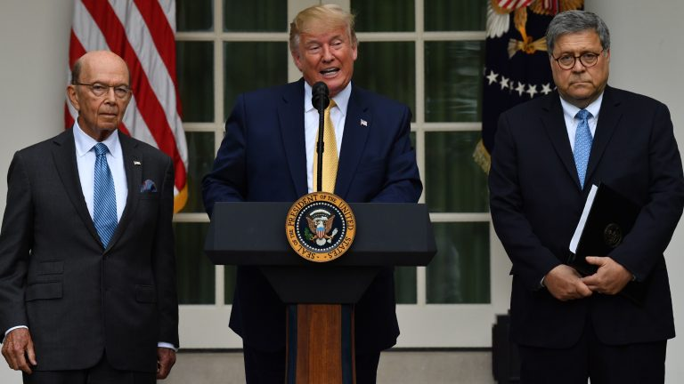 President Trump, flanked by Secretary of Commerce Wilbur Ross (left) and Attorney General William Barr, delivers remarks on citizenship and the census in the Rose Garden at the White House on Thursday. (Nicholas Kamm/AFP/Getty Images)