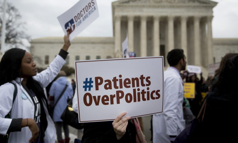 Demonstrators from Doctors for America marched in support of the Affordable Care Act outside the U.S. Supreme Court in March 2015. Now, another caseaims to undo the federal health law: Texas v. United States could land in front of the Supreme Court ahead of the 2020 election