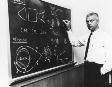 American aerospace engineer John Houbolt as he stands at a chalkboard in July 1962 showing his lunar orbit rendezvous plan for landing astronauts on the moon. (NASA/LARC/Bob Nye/PhotoQuest/Getty Images)