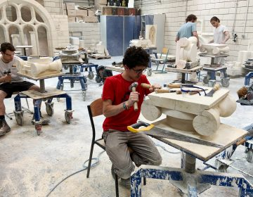 Students chip and chisel away at heavy slabs of stone in the workshops of the Hector Guimard high school, less than three miles from Paris' Notre Dame cathedral. (Eleanor Beardsley/NPR)