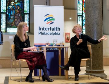 Krista Tippett and WHYY's Jennifer Lynn engage with the crowd during the 2019 Dare to Understand Awards hosted at the Philadelphia Episcopal Cathedral.  Riley Jackson/Interfaith Philadelphia