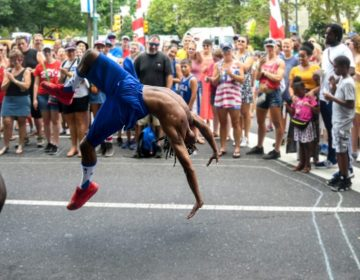 Acrobatic performers wowed the crowd at the Welcome America Party on the Parkway. (Michael Reeves/Billy Penn)