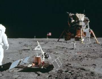 In this July 20, 1969 photo made available by NASA, astronaut Buzz Aldrin Jr. stands next to the Passive Seismic Experiment device on the surface of the the moon during the Apollo 11 mission. (Neil Armstrong/NASA via AP)