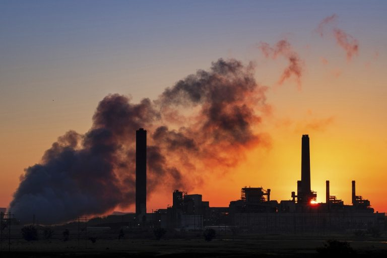In this photo, the Dave Johnson coal-fired power plant is silhouetted against the morning sun in Glenrock, Wyo. (J. David Ake/AP Photo)