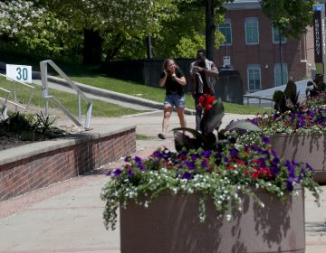 In this photo from Friday, May 24, 2019, visitors walk through the campus of Slippery Rock University in Slippery Rock, Pa. (Keith Srakocic/AP Photo)