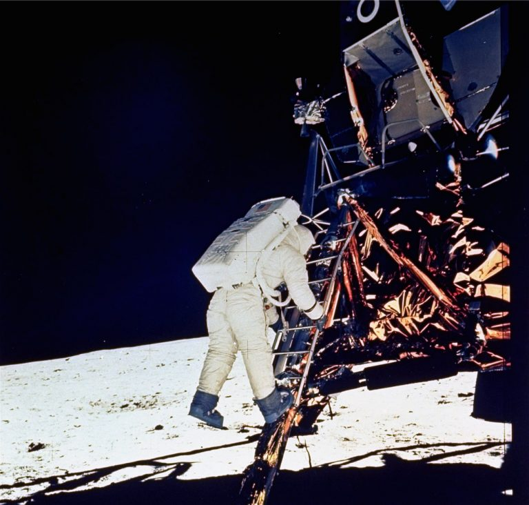 Astronaut Edwin E. Aldrin, Jr., lunar module pilot, descends steps of Lunar Module ladder as he prepares to walk on the moon, July 20, 1969. This picture was taken by astronaut Neil A. Armstrong, Commander