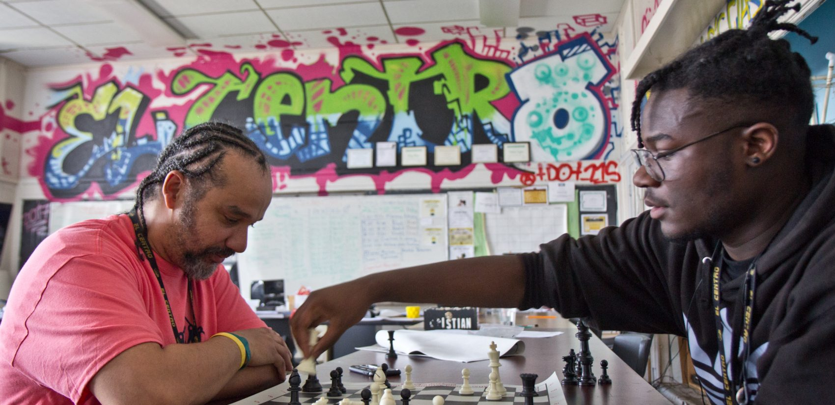 Doug Cox (left) teaches mathematics and engineering at El Centro. He also leads the Dark Knights chess club. (Kimberly Paynter/Keystone Crossroads)